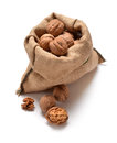 Walnuts and a bag on white Royalty Free Stock Photos