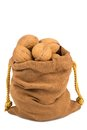 Walnuts and a bag on white in isolated background Royalty Free Stock Photo