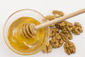 Walnuts and bowl of honey on a table Royalty Free Stock Photo