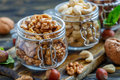 Walnuts and cashews in glass jars. Royalty Free Stock Photo