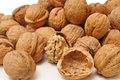 Walnuts and a cracked walnut Royalty Free Stock Photography
