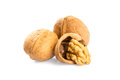 Walnuts and  cracked walnut Royalty Free Stock Photo