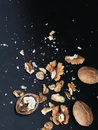 Walnuts crumb on a black backgrund Royalty Free Stock Image