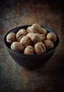 Walnuts dark ceramic bowl Royalty Free Stock Photos