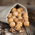 Walnuts fresh on wooden ground Royalty Free Stock Photo