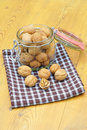 Walnuts in a glass on a table Stock Images