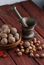 Walnuts and hazelnuts on rustic dark wood background Royalty Free Stock Photos