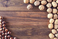 Walnuts and hazelnuts in shells on a board Royalty Free Stock Photography