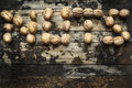 Walnuts, laid out in the word nuts on wooden rustic background, top view Royalty Free Stock Photo