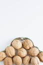 Walnuts and nutcracker white background Royalty Free Stock Image