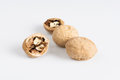 Walnuts and nutcracker white background Royalty Free Stock Photos