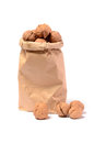 Walnuts in a paper bag on a white background Stock Image