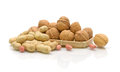 Walnuts and peanuts on a white background Royalty Free Stock Photography