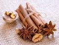 Walnuts star anise cinnamon sticks burlap background Stock Photo