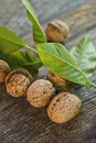 Walnuts on table old wooden walnut leaf in background selective focus with shallow depth of field Royalty Free Stock Image