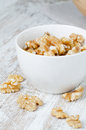 Walnuts in white porcelain cup Stock Photos