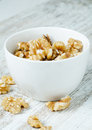 Walnuts in white porcelain cup Stock Image