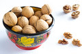 Walnuts in a wooden bowl color white background Stock Photos