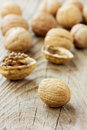 Walnuts on a wooden rustic board Royalty Free Stock Photography
