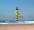 Wandering indian tightrope walker playing on the beach of Goa Royalty Free Stock Photo