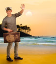 From the wanderings returning portrait of a gay sailor with a suitcase on a white background Stock Image