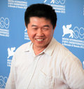 Wang bing poses for photographers at th venice film festival on september in venice italy Stock Images