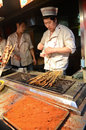 Wangfujing snack street in beijing man preparing food china Royalty Free Stock Photos
