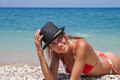 Wanna swim beautiful woman sunbathing on the beach Royalty Free Stock Images