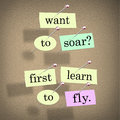 Want to soar first learn to fly words saying quote the on pieces of paper pinned a bulletin board a motivational bit of advice Stock Photos
