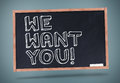 We want you written on chalkboard against grey background Royalty Free Stock Photography