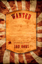 Wanted dead or alive vintage poster with curled edge hanging on the wall Royalty Free Stock Image