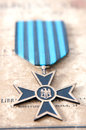War distinction old medal from the nd world on an old paper Royalty Free Stock Image