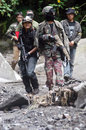War game hobbyists playing with airsoft gun in the woods in boyolali central java indonesia Stock Photo