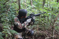 War game hobbyists playing with airsoft gun in the woods in boyolali central java indonesia Stock Photography