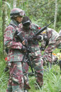 War game hobbyists playing with airsoft gun in the woods in boyolali central java indonesia Royalty Free Stock Photos