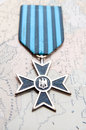 War medal old from the nd world on an old map Royalty Free Stock Images