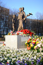 War memorial children surrounded with flowers at its opening near the piskaryovskoye cemetery on may in st petersburg Royalty Free Stock Photo