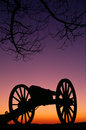 War memorial wheeled cannon military civil war weapon dusk sunset relics from prior american sit in the Stock Images