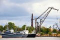 War ship and tug boat in port near crane Royalty Free Stock Photo
