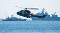 War simulation military helicopter and battle ship Stock Photo