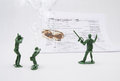 A war on taxes with army men group of plastic are fighting by shooting at form Stock Photo