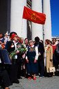 War veterans sing war songs red flag waves above them moscow may victory day celebration in moscow Stock Photo