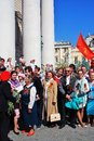 War veterans sing war songs soviet army red flag waves above people moscow may victory day celebration in moscow Royalty Free Stock Image