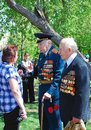 War veterans speak to a woman in the park victory day celebration in the gorky park on may in moscow Stock Photos