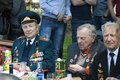 War veterans and their relatives celebrate victory day in gorki park moscow may moscow they sit at table Royalty Free Stock Photography