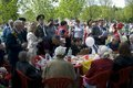 War veterans and their relatives celebrate victory day in gorki park moscow may moscow they sit at table Stock Image