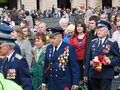 War veterans and young people walking together holding flowers victory day celebration on the nevskiy prospect military parade Stock Image