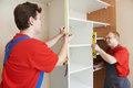 Wardrobe joiners at installation work Royalty Free Stock Photo
