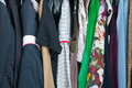 Wardrobe with lots of clothes on hangers Royalty Free Stock Photo