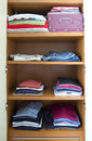 Wardrobe summer clothes in a tidy Stock Image